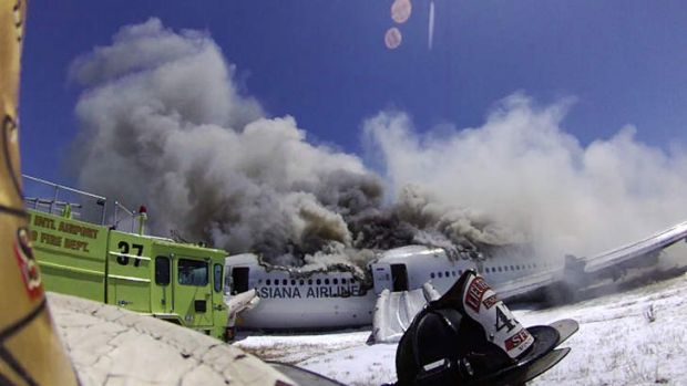 A camera mounted on a firefighter's helmet captures the moments after the plane crashed.