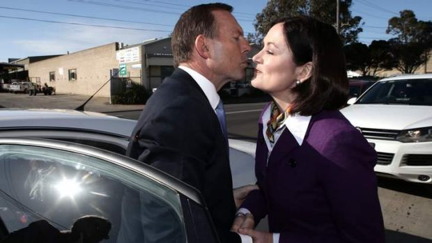 Opposition Leader Tony Abbott greets Liberal candidate Sarah Henderson.