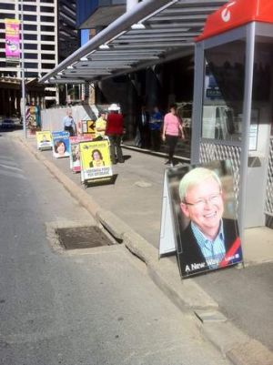 Candidates' signs outside the Electoral Commission's offices in Queen Street.