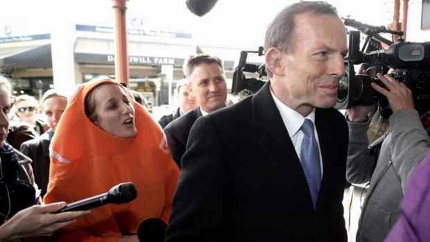 Clowning around: Koel Wrigley heckles Tony Abbott about the Great Barrier Reef.