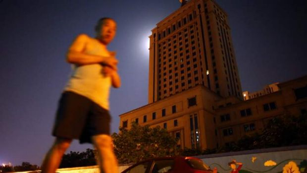 A man walks past the Jinan Intermediate People's Court building, where the trial of disgraced Chinese politician Bo ...