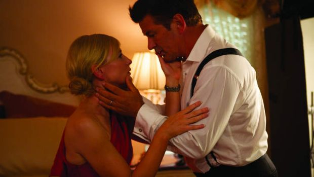 Mesmerised ... Alec Baldwin with Cate Blanchett in a scene from Woody Allen's <i>Blue Jasmine</i>.