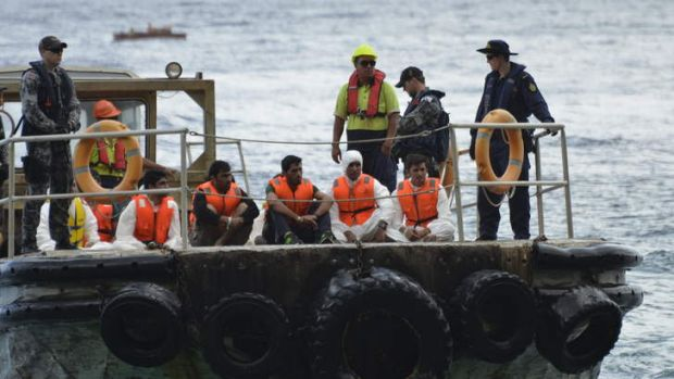 The HMAS Parramatta offloads on Christmas Island asylum seekers from Iraq, Iran and Pakistan after their boat capsized ...