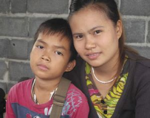 """A wake-up call for Buddhist people"": Ying with her 11-year-old son Nom, who was fathered by Wirapol Sukphol."