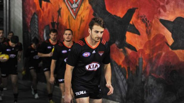 Essendon captain Jobe Watson with teammates before last week's match with North Melbourne.