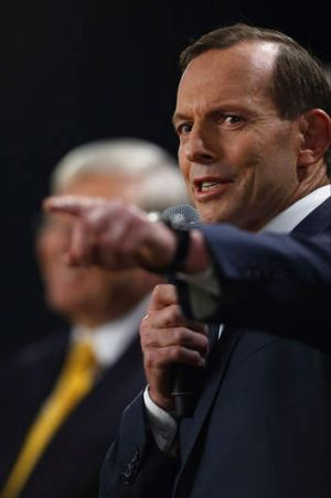 Tony Abbott makes a point during Wednesday night's debate in Brisbane.