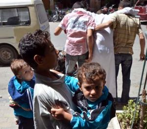Survivors: Children who survived what activists say was a gas attack are seen walking through the Duma neighbourhood of ...