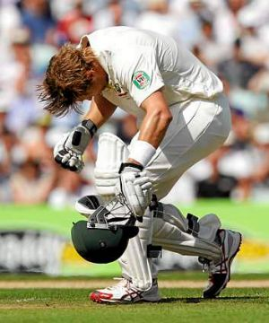 Reeling: Watson stumbles after being hit by a bouncer.