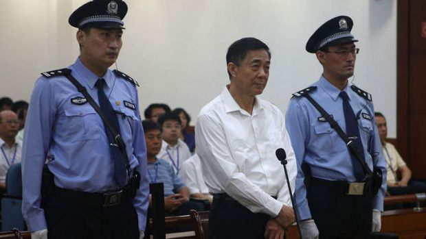 'Trial of the century': Bo Xilai in court on Thursday, flanked by two policemen.