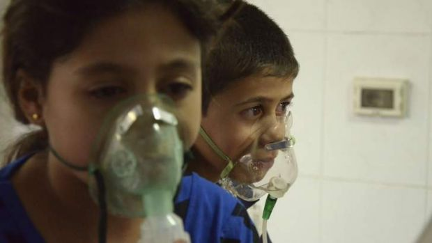 Children are treated with oxygen after what activists say was a gas attack in a Damascus suburb.