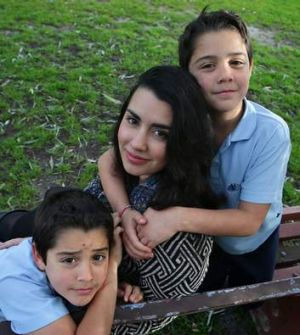 Bianca Maciel Pizzorno, with her sons Carlos (left) and Alessandro, feels lucky despite her battle to make ends meet.