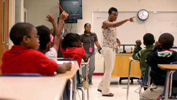 Ronald E. McNair Discovery Learning Academy first-grade teacher Sherlita Bickham directs her class on the day after the ...