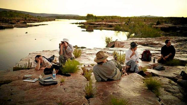 Artists enjoy the sunset at Sir John Gorge, in the Australian Wildlife Conservancy in the Kimberley.
