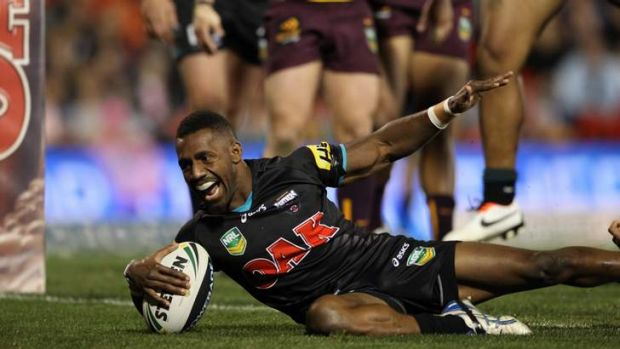 Magic man: James Segeyaro scores one of three tries for the Panthers.