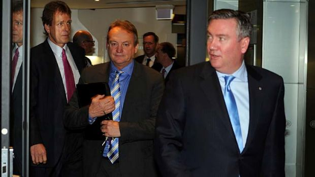 Eddie McGuire emerges from the meeting of AFL club presidents on Thursday.