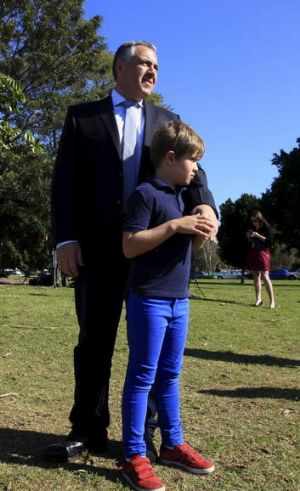 Joe Hockey with his son Xavier, 8, at a funding announcement in Concord, Sydney.