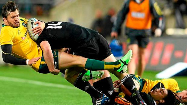 Adam Ashley-Cooper on the receiving end of an All Black tackle during Saturday's Bledisloe Cup game.