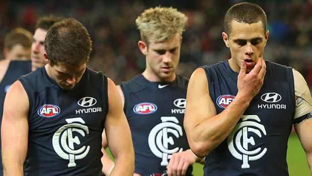 Blues players look dejected after losing the round 22 match to Essendon. But they could be smiling after the final round.