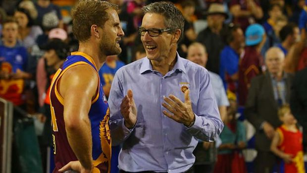 Brisbane Lions chairman Angus Johnson (right) congratulates Joel Patfull after the win over the Western Bulldogs on Sunday.