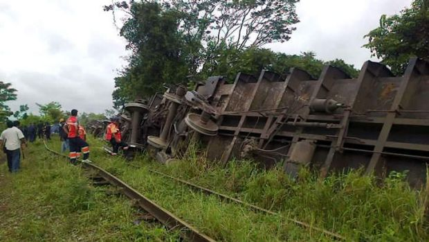 "Rescuers observing the train known as ""The Beast"", after it derailed near Huimanguillo, in Tabasco State, Mexico."