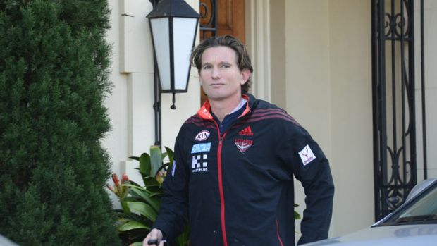 Essendon coach James Hird leaves his Toorak home on Monday morning.