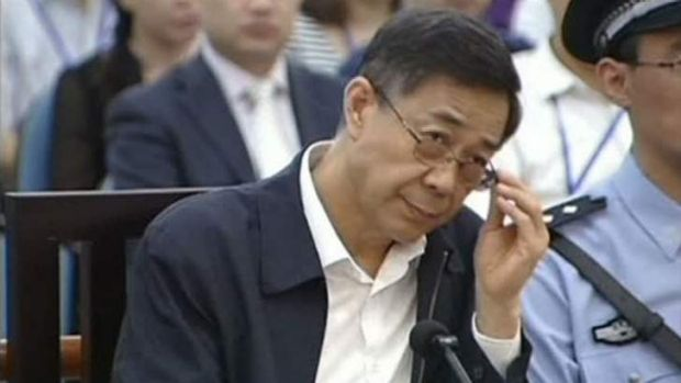 Ousted senior Chinese politician Bo Xilai attends the fifth day of his trial at the Jinan Intermediate People's Court in ...