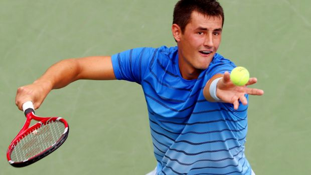 Bernard Tomic is through to the second round at the US Open.