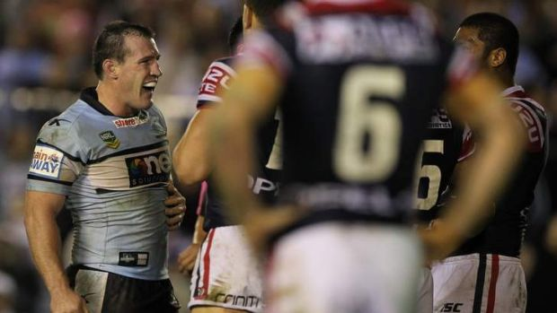 Standing up to the opposition: Cronulla captain Paul Gallen takes on the Roosters on Monday night.