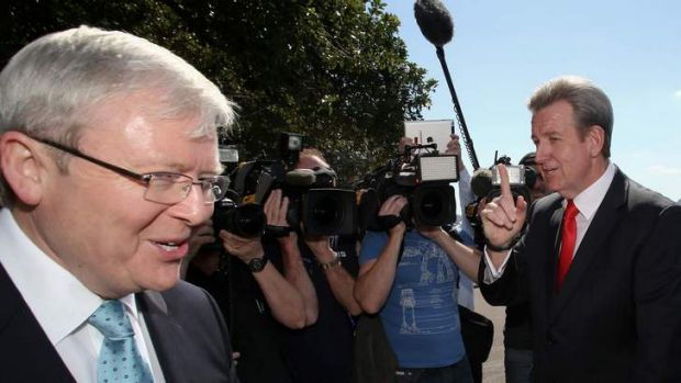 NSW Premier Barry O'Farrell confronts Prime Minister Kevin Rudd near the Garden Island Naval facility in Sydney on Tuesday.
