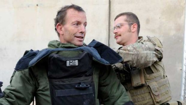 Tony Abbott tries on a bomb-disposal suit at Tarin Kowt base in Afghanistan.