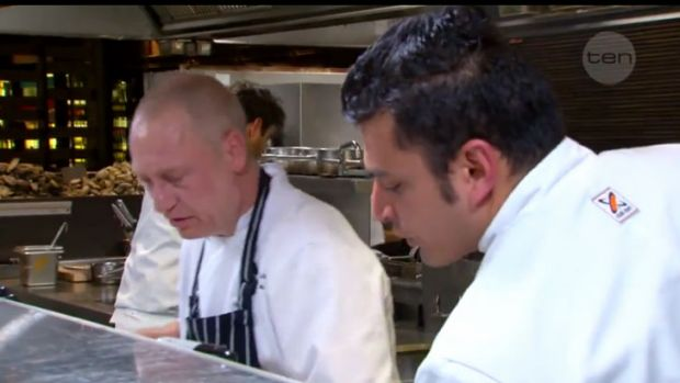 Donovan and Rishi discuss the finer points of rice soup. <i>MasterChef</i>