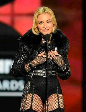 "Madonna accepts the award for ""Touring Artist of the Year"" onstage during the 2013 Billboard Music Awards."
