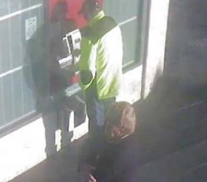 Police believe the man seen at rear has vital information about the case.