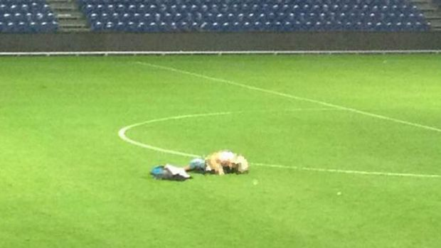 A pixellated version of a photo circulating on Twitter of a couple's amorous embrace on the field of Brondby football ...