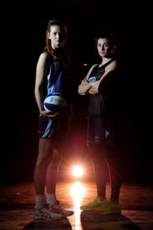 Canberra Capitals Carley Mijovic and Alex Bunton.