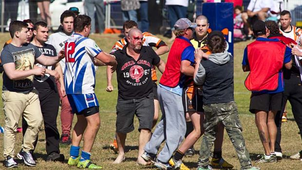 Players and spectators involved in a brawl at Turnbull Oval.