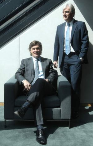 'There is no denying it's tough': Westfield co-chief executives Peter Lowy (seated) and his brother Steven.