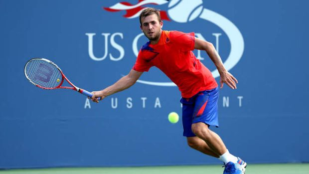 Daniel Evans of Great Britain in action against Bernard Tomic on day four of the 2013 US Open.