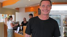 Grant Richards at the Having a Go cafe at Coorparoo, which employs homeless people
