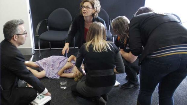 First aid is offered to a young girl who fainted at a press conference with Kevin Rudd in Perth.
