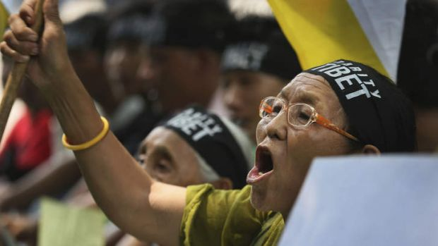A Tibetan exile woman shouts slogans against the Chinese government during a rally to mark Tibet Solidarity Day in New Delhi.