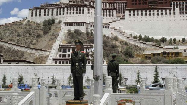 Paramilitary policemen guard the Potala Palace in Lhasa, Tibet. The June visit by US Ambassador Gary Locke was used as ...