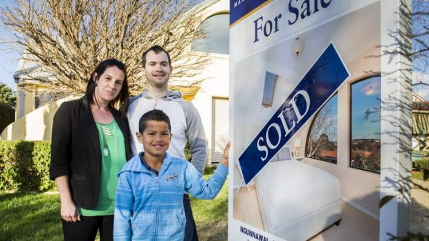 First home buyers Ashley and Terry Lock with their 8y/o son Roman Quarmby outside their new home.