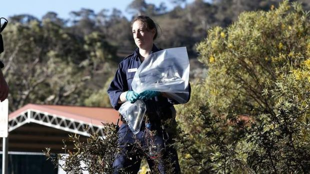 ACT Policing and Forensics members gathers evidence at a second site following a suspected pipe bomb being discharged.