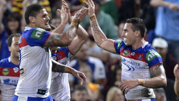 Happy knights: Darius Boyd celebrates with Willie Mason.