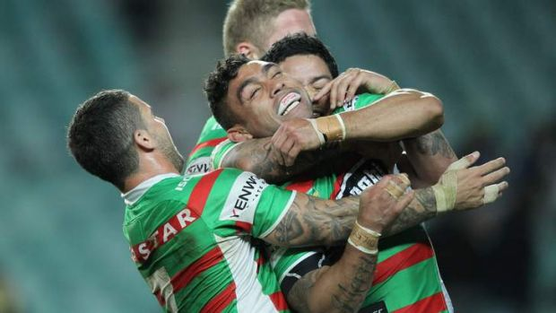 Nathan Merritt is mobbed by teammates on Friday night.