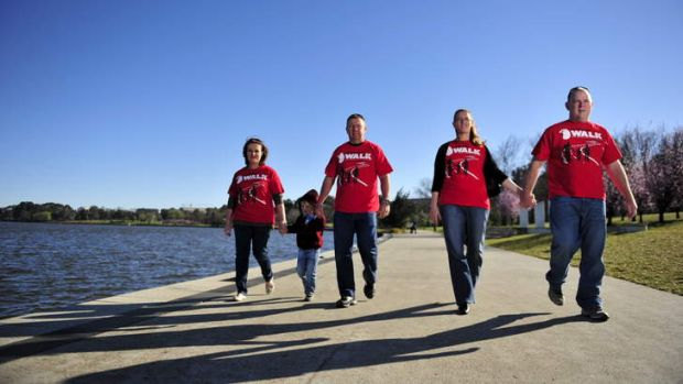 Kim and Gavin Fitt with their son Riley, 4,  and Paula and Andrew Moloney prepare for the big red kidney walk.