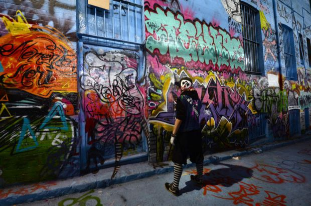 A graffiti artist at work in Rutledge Lane in Melboure on August 30, 2013.