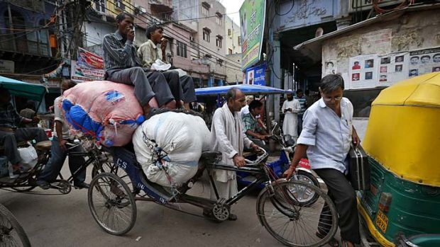 Crisis: A bustling street in Delhi suggests it is business as usual, but the reality under the surface is a much more ...