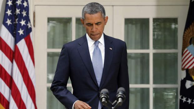 President Barack Obama arrives to make a statement about Syria in the Rose Garden at the White House in Washington, ...